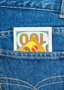 Credit card MasterCard with US dollars sticking out of the back jeans pocket Stock Photos