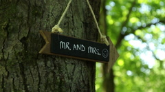 Mr & Mrs wedding sign on a tree Stock Footage