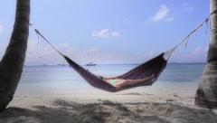 Relaxing beach hammock - stock footage