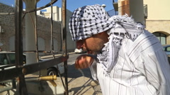 Saudi arabian man drinking water from fountain Stock Footage