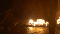 Man is Putting Out a Fire by Wet Cloth Torch Slowly Fire Requisite Props of Stock Footage