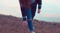 Girl throwing rocks in the lake Stock Footage