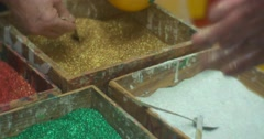 Person is Pouring a Golden Glitter Shaking It Off a Christmas Balls Colorful Stock Footage