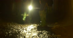 Backpacker Lights a Way Behind Him Water Stream Man in Gumboots Takes a Photo Stock Footage