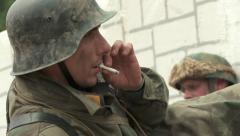 WW2 German Soldier smoking a Cigarette before battle Stock Footage
