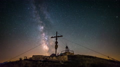 Time Lapse - Hikers on a mountain at the cross at night Stock Footage