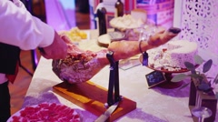 Slice the ham slices on a banquet Stock Footage