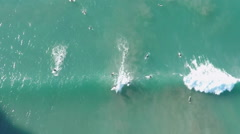 Aerial drone view of Surfers catching waves in california Stock Footage