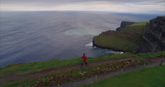 Man walking along the Cliffs of Moher - stock footage