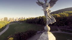 Aerial drone view flying over Mont Royal and the angel statue in Montreal with Stock Footage