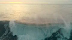 Aerial drone view of ocean wave breaking at sunset Stock Footage