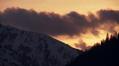 Timelapse sunset mountain peak and trees in winter Stock Footage