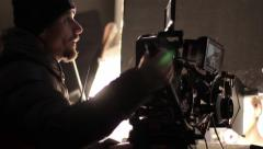 The cameraman working on the set of the film. Film production - stock footage