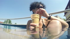 Female model in spa pool drink coffee Stock Footage