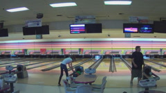 People Bowling At Bowling Alley Stock Footage