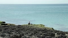Lone Chinese fisherman fishing in ocean Stock Footage