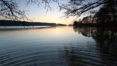 Sunset over beautiful lake in Poland. Mazury lake district Stock Footage