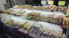 Exotic foods for sale at Chinese night market in Taiwan Stock Footage