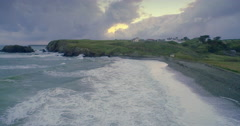 Aerial drone view of cliff edge on a stormy day sunset in Annestown, Ireland Stock Footage