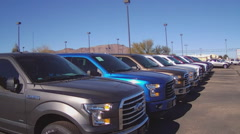 Row Of New Pickup Trucks At Car Dealership 1 - stock footage