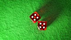 Red dices on the green cloth background. Rotation. Double four. Top view. Stock Footage
