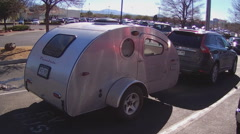 Small Teardrop Mini Camper And Car In Parking Lot  Stock Footage