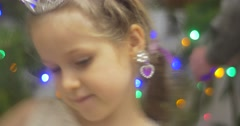 Girl in Crown and Earrings With Violet Stones Dancing at the New-Year Tree Pine Stock Footage