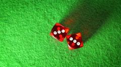 Red dices on the green cloth background. Rotation. Double three. Top view. Stock Footage