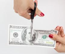 100 dollar cut with scissors on white Stock Photos