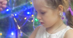 Girl and Her Father Untie a Blue Beads Garland Going to Put it to New-Year Tree Stock Footage