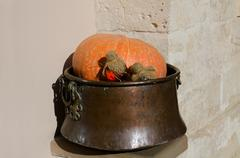 Pumpkin with bottles of potions in a copper vat on wall background. Horizonta - stock photo