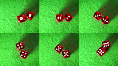 Red dices on the green cloth background. Rotation. Compilation. - stock footage