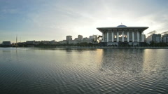 Islamic architecture by a lake. Morning pan shot from - stock footage