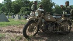 WW2 German Motorcyclist climbs out of sidecar Stock Footage
