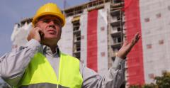 Irritated Engineer Phone Talking Decision Give Orders Construction Workers Team Stock Footage