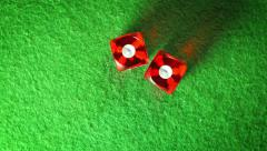 Red dices on the green cloth background. Rotation. Double one. Top view. Stock Footage