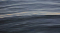 Moving close up surface of lake at sunset Stock Footage
