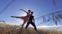 Female ballet dancer leaning into male ballet dancer in slow motion Stock Footage