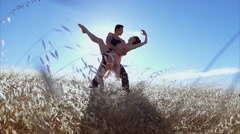 Female ballet dancer leaning back with male ballet dancer in slow motion in the Stock Footage