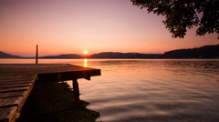 Time Lapse - Sunset at the lake with a jetty Stock Footage