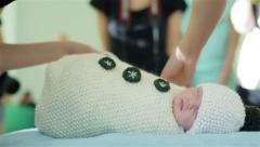 Newborn baby is prepared for photo session Stock Footage