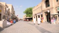 People walk in the Souq Waqif in Doha, Qatar Stock Footage