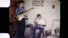 Young Men Playing Rock and Roll Music Guitar Vintage Film Home Movie 9050 Stock Footage