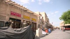 Establishing shot of traditional stores in Doha, Qatar Stock Footage