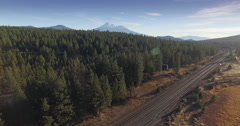 Aerial drone view of dry grass field and Mount Shasta in Northern California Stock Footage