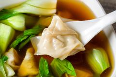 Chinese wanton soup with bok choy ready to eat Stock Photos