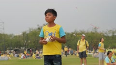 Boy kiting with bike for dad yellow shirt,Bangkok,King birthday,Thailand Stock Footage