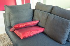 Modern apartments cozy furniture: a sofa with pillows Stock Photos