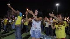Young people lighting candle for kings birthday,Bangkok,King birthday,Thailand Stock Footage