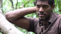 Serious African Man at Tree Stock Footage